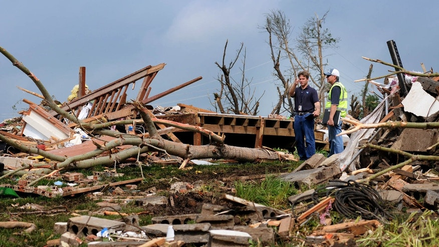 Meteorologists with the National Weather Service inspect the destruction Thursday morning, May 25, 2016, of a rural home north of Abilene, Kan.