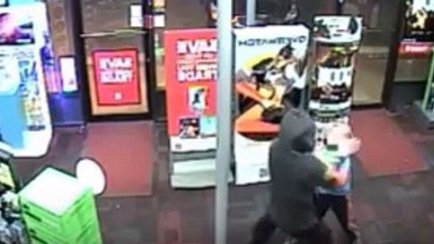 Surveillance video shows boy resisting armed robber with stuffed toy. (Montgomery County Police Department)