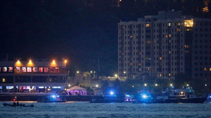 May 27, 2016: Search and rescue boats look for a small plane that went down in the Hudson River.