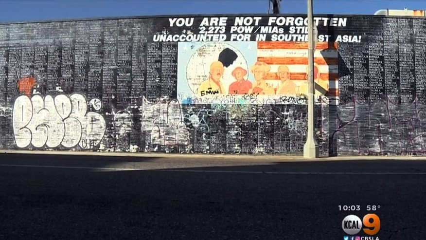 This Friday, May 27, 2016 image from video provided by KCBS-TV/KCAL-TV shows graffiti on a Vietnam War memorial in the Venice area of Los Angeles.