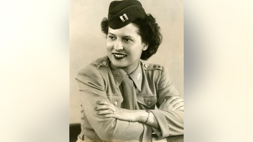 In this 1940's photo provided by the OSS Society, U.S. Army Capt. Stephanie Rader poses for a photograph. Rader was recommended for the Legion of Merit in 1946 for her intelligence on Soviet troop movements in Poland, but her nomination was not acted upon for seven decades. Rader, who was a groundbreaking spy for America in post-World War II Poland is being laid to rest Wednesday, June 1, 2016, at Arlington National Cemetery.  (OSS Society via AP)