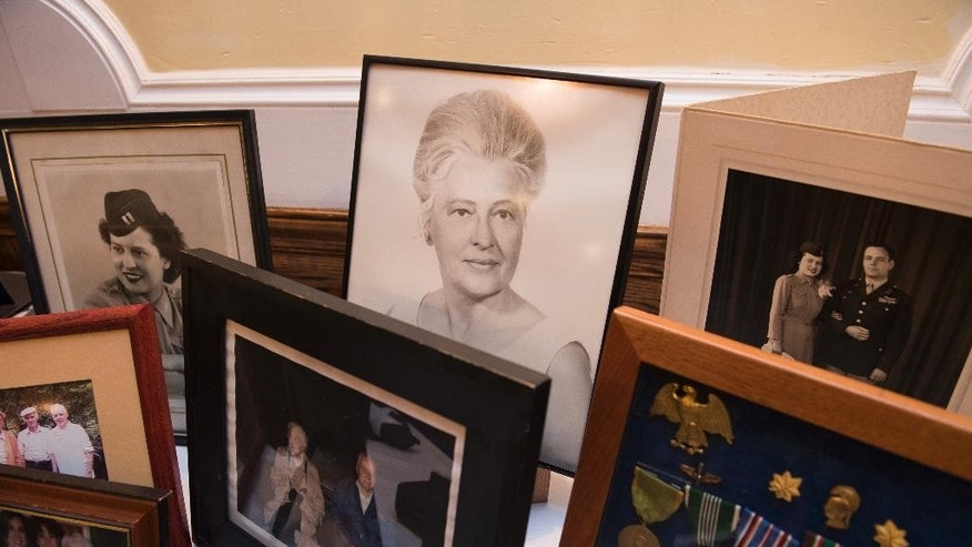 Photographs of Stephanie Rader, and other items are displayed during a reception following her full honors funeral, at Fort Myer in Arlington, Va., Wednesday, June 1, 2016. Rader was an American spy in post-World War II Poland and was posthumously awarded the Legion of Merit 70 years after her nomination. (AP Photo/Molly Riley)
