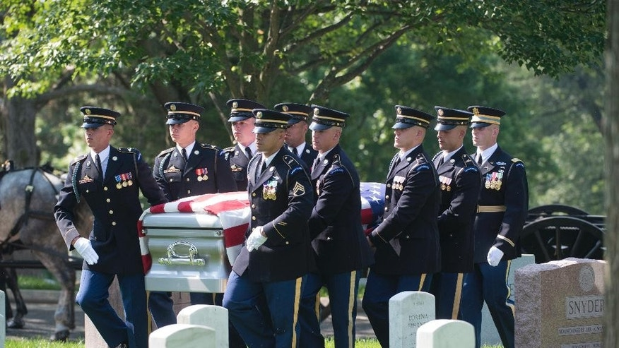 The casket of Stephanie Rader is carried during a full military honors conducted by the Army's 3rd U.S. Infantry Regiment at Arlington National Cemetery in Arlington, Va., Wednesday, June 1, 2016. Rader, who was an American spy in post-World War II Poland was posthumously awarded the Legion of Merit Wednesday, 70 years after her nomination. (AP Photo/Molly Riley)