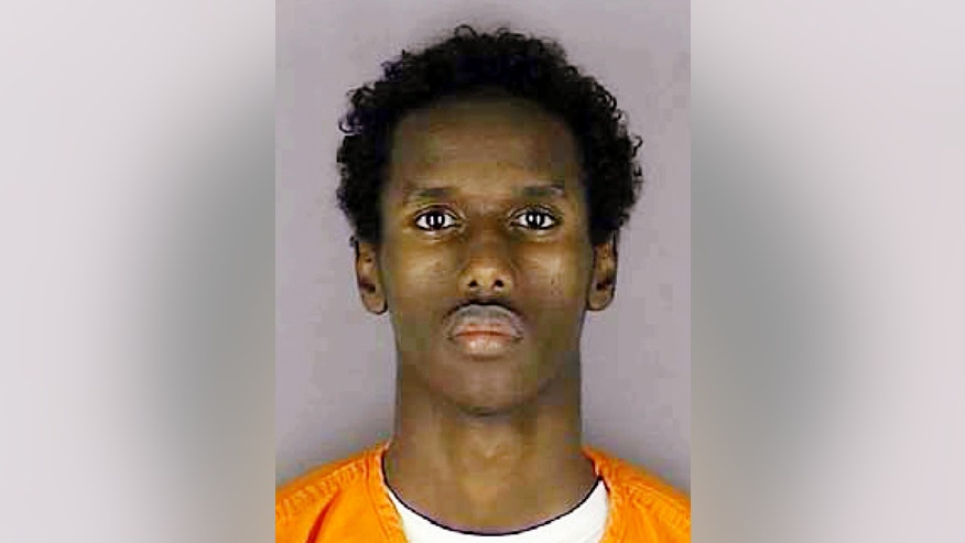 FILE - This undated file photo provided by the Hennepin County Sheriff's Office shows Guled Ali Omar, one of several Minnesota men accused of conspiring to travel to Syria to join the Islamic State group. Closing arguments are scheduled to begin Tuesday, May 31, 2016, in the trial for Omar and two other men in Minneapolis. (Hennepin County Sheriff's Office via AP, File)