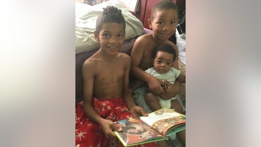 This undated image shows Jaikare Rahaman, Jeremiah Adams and Avery Robinson, who police say were stabbed and killed by their mother June 2, 2016