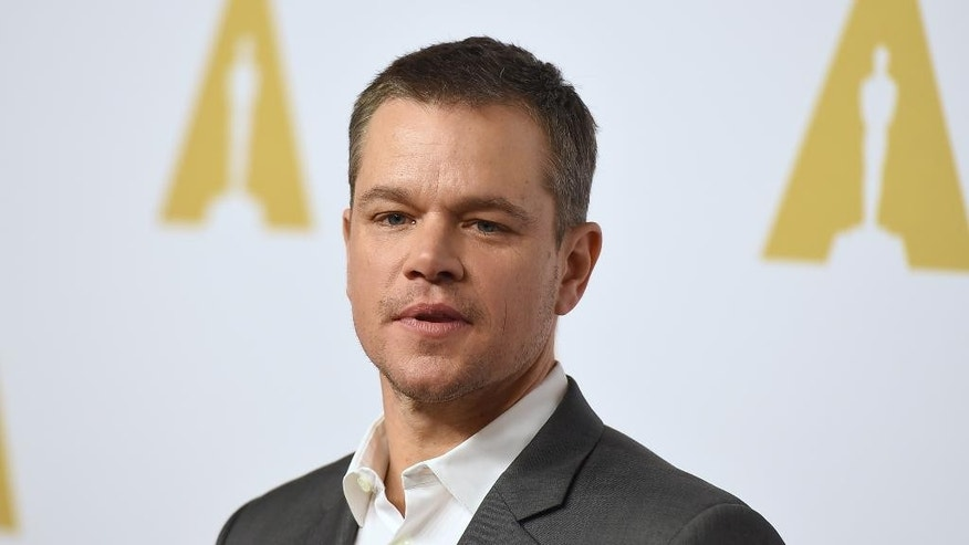 "FILE- In this Feb. 8, 2016, file photo, Matt Damon arrives at the 88th Academy Awards Nominees Luncheon at The Beverly Hilton hotel in Beverly Hills, Calif. Matt Damon is returning to the campus of the Massachusetts Institute of Technology, where he played a mathematically gifted custodian in the 1997 hit movie ""Good Will Hunting,"" to deliver the commencement address on Friday, June 3. (Photo by Jordan Strauss/Invision/AP, File)"