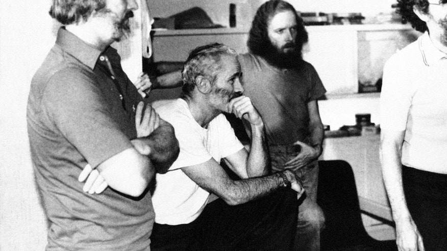 FILE - In this Dec. 25, 1980, file photo, four American hostages, from left, William Belk of Columbia, S. C.; Thomas Schaefer of Tacoma, Wash.; Donald Hohman of West Sacramento, Calif.; and John Craves of Reston, Va., listen to the latest demands for their release in Iran. Schaefer, a retired Air Force colonel who was the ranking military officer among the 52 Americans held hostage in Tehran, Iran for 444 days before being released in 1981, has died Tuesday, May 31, 2016, of congestive heart failure Tuesday at a hospice in Scottsdale. Ariz., his sone David Schaefer said Friday, June 3, 2016. He was 85. (AP Photo/File0