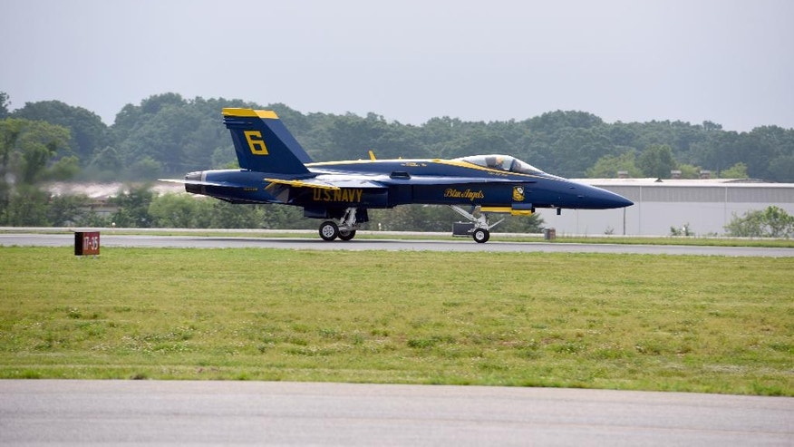 In this May 19, 2016, photo Marine Capt. Jeff Kuss lands his plane at an air show in Lynchburg, Va. A Blue Angels F/A-18 fighter jet crashed Thursday, June 2, near Nashville, Tenn., killing the pilot just days before a weekend air show performance, officials said. A U.S. official said the pilot was Kuss. (Matt Bell/The Register & Bee via AP) MANDATORY CREDIT