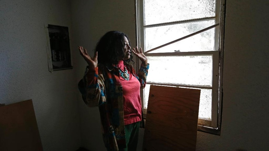 In this Dec. 11, 2015 photo, Barbara Hicks Collins talks of her upbringing, in her childhood home, now listed on the National Register of Historic Places, in honor of her father, civil rights activist Robert Hicks, in Bogalusa, La. The home was both the site of mobilization of civil rights activism, and the target of Ku Klux Klan hostility. (AP Photo/Gerald Herbert)