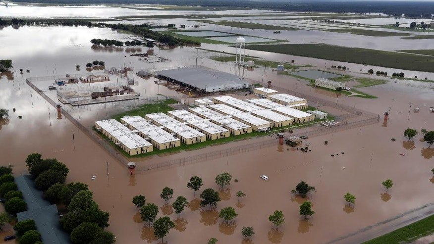 An evacuated Texas Department of Criminal Justice prison surrounded by floodwaters is shown in this aerial view near Lochridge, Texas, Saturday, June 4, 2016. Parts of Texas have been inundated with rain in the last week, and more than half of the state has been under flood watches or warnings. (AP Photo/David J. Phillip)