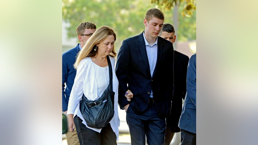FILE - In this June 2, 2016 file photo, Brock Turner, right, makes his way into the Santa Clara Superior Courthouse in Palo Alto, Calif. A letter written by Turner's father was made public over the weekend by a Stanford law professor who wants the judge in the case removed from office because Brock Turner's sentencing. (Dan Honda/Bay Area News Group via AP, File) MAGS OUT NO SALES