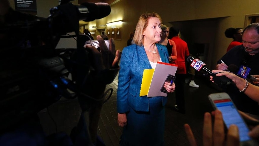 Shelby County Deputy District Attorney Jennifer Nichols talks to members of the media following the video arraignment of Justine Welch on Monday, June 6, 2016, in Memphis, Tenn. Welch is charged with shooting multiple people and then fatally striking a Memphis police officer with a stolen car. (Mike Brown/The Commercial Appeal via AP) MANDATORY CREDIT