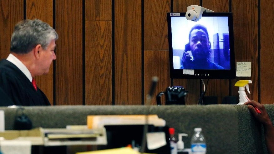 Justine Welch makes a video arraignment appearance before Judge Louis Montesi Jr. on Monday, June 6, 2016, in Memphis, Tenn. Welch is charged with shooting multiple people and then fatally striking a Memphis police officer with a stolen car. (Mike Brown/The Commercial Appeal via AP) MANDATORY CREDIT
