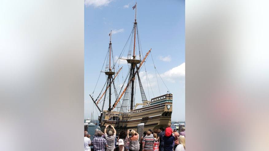 People on a wharf, bottom, watch as the Mayflower II arrives in Plymouth Harbor, Monday, June 6, 2016, in Plymouth, Mass. The 1957 replica of the famed ship that carried the Pilgrims to Massachusetts in 1620 has been undergoing an extensive restoration at the Henry B. DuPont Preservation Shipyard, at Mystic Seaport, in Mystic, Conn., in the run-up to Plymouth's 400th anniversary in 2020. (AP Photo/Steven Senne)