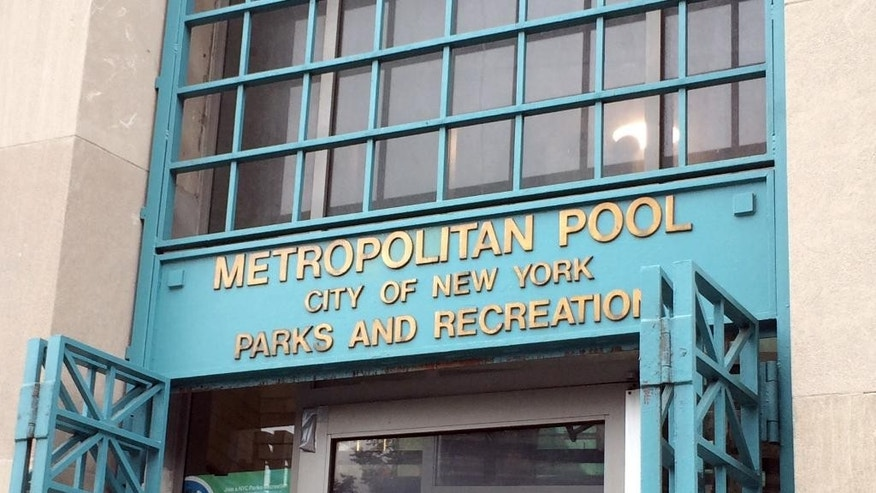The doors are open at the Metropolitan Pool in the Williamsburg neighborhood in the Brooklyn borough of New York, Monday, June 6, 2016. The public pool that maintains female-only hours so that women can swim with no men present has raised alarms among critics who say the accommodation to a particular religious group violates the constitutional separation of church and state. But defenders say the women-only swim sessions at the Metropolitan Recreation Center give women whose community separates the sexes a rare chance to exercise. (AP Photo/Rachelle Blidner)