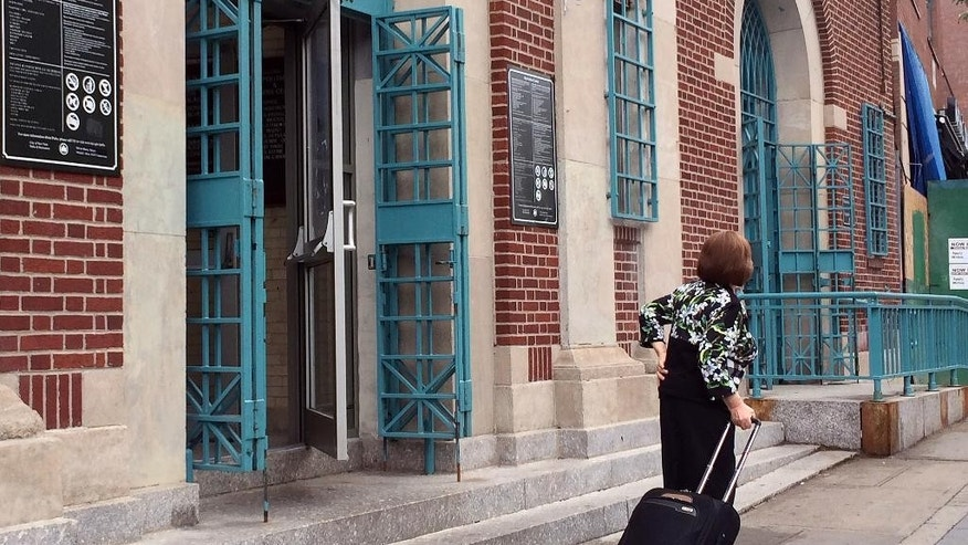 A Hasidic Jewish woman leaves the Metropolitan Pool in the Williamsburg neighborhood in the Brooklyn borough of New York, Monday, June 6, 2016. The public pool that maintains female-only hours so that women can swim with no men present has raised alarms among critics who say the accommodation to a particular religious group violates the constitutional separation of church and state. But defenders say the women-only swim sessions at the Metropolitan Recreation Center give women whose community separates the sexes a rare chance to exercise. (AP Photo/Rachelle Blidner)