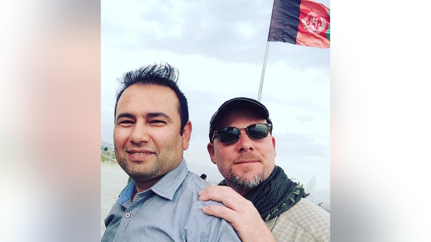 This undated photo provided by NPR shows Zabihullah Tamanna, left, and David Gilkey. Gilkey, a veteran news photographer and video editor for National Public Radio, and Tamanna, an Afghan translator, were killed while on assignment in southern Afghanistan on Sunday, June 5, 2016, a network spokeswoman said. (Monika Evstatieva/NPR via AP) MANDATORY CREDIT