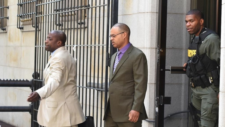 Baltimore Police Officer Caesar Goodson, center, leaves Courthouse East with his lawyer Matthew Fraling on Monday, June 6, 2016, in Baltimore. Caesar Goodson, who was driving the transport wagon, faces second-degree murder, manslaughter, assault, misconduct in office and reckless endangerment charges in the death of Freddie Gray. (Jerry Jackson/The Baltimore Sun via AP)  WASHINGTON EXAMINER OUT; MANDATORY CREDIT