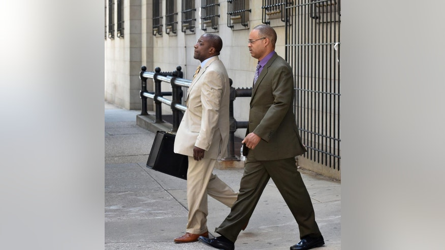 Baltimore Police Officer Caesar Goodson, right, leaves a motions hearing with his lawyer Matthew Fraling on Monday, June 6, 2016, in Baltimore. Goodson, who was driving the transport wagon, faces second-degree murder, manslaughter, assault, misconduct in office and reckless endangerment charges in the death of Freddie Gray. (Jerry Jackson/The Baltimore Sun via AP)  WASHINGTON EXAMINER OUT; MANDATORY CREDIT