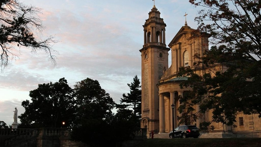FILE - This Sept. 27, 2015, file photo shows St. Martin's Chapel at dawn before an address by Pope Francis at St. Charles Borromeo Seminary in Wynnewood, Pa. St. Charles Borromeo Seminary, founded in 1832 and based at its current location for nearly 150 years, announced Tuesday, June 7, 2016, that it wants to affiliate with a local Roman Catholic college or university and move its entire operation into newly constructed buildings on or near that school's campus. (AP Photo/Mel Evans, File)