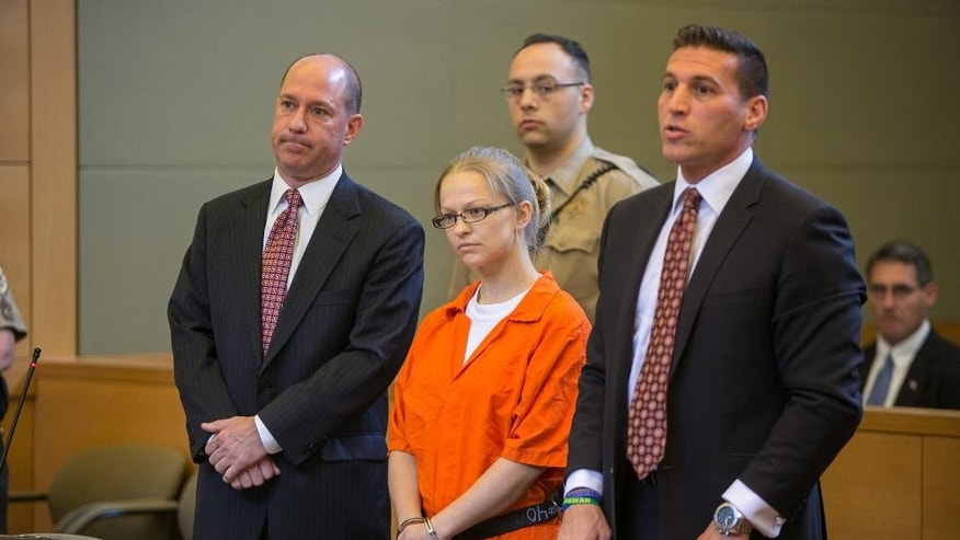 FILE - In this May 29, 2015 file photo, Angelika Graswald, center, stands in court with her attorneys Jeffrey Chartier, left, and Richard Portale at her arraignment in Goshen, N.Y. Authorities say Graswald removed a drain plug from Vincent Viafore's kayak in April 2015 and pushed a floating paddle away from him after his kayak capsized. A Cornwall police officer testified Monday, June 7, 2016, Graswald appeared calm and emotionless after she was rescued. (Allyse Pulliam/Times Herald-Record via AP, Pool, File) MANDATORY CREDIT
