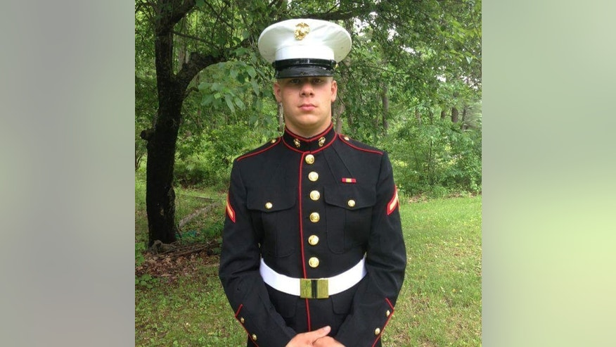 In this June 2013 family handout photo provided by Jessie Kelly, Marine Lance Cpl. Brandon Garabrant is seen in his military uniform in Greenfield, N.H., before he was killed in the line of duty, June 20, 2014, in Afghanistan. When Garabrant graduated from high school he wanted to wear his Marine uniform but school officials said policy bans uniforms and requires graduates to wear blue caps and gowns. A new state law passed this year now allows high school graduates to wear their military uniforms if they have completed basic training. (Jessie Kelly via AP)