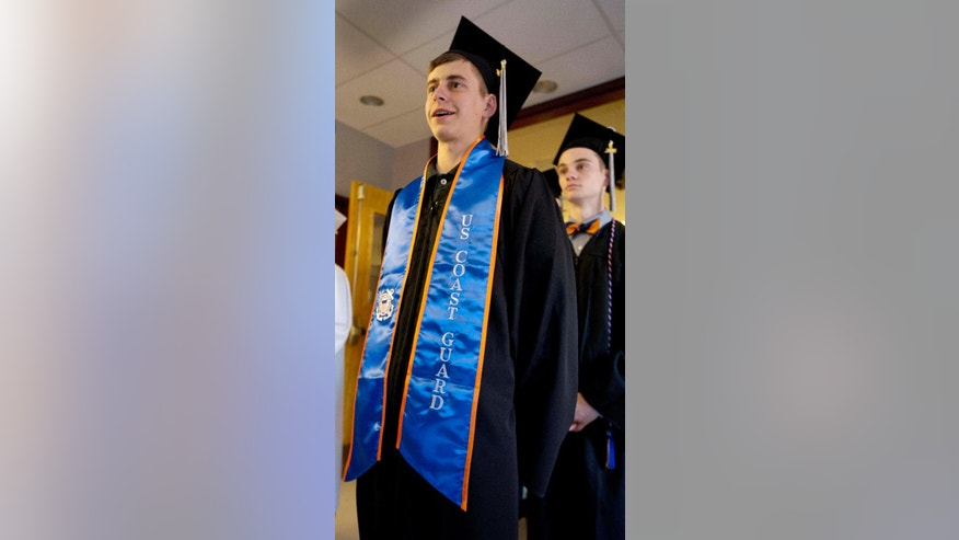 In this Friday June 3, 2016 photo, high school graduate Hunter Michaud marches wearing his U.S. Coast Guard graduation sash with his class in Alton, N.H. New Hampshire has passed a law that allows students to wear their uniform during graduation ceremonies if they have completed basic training. (AP Photo/Jim Cole)