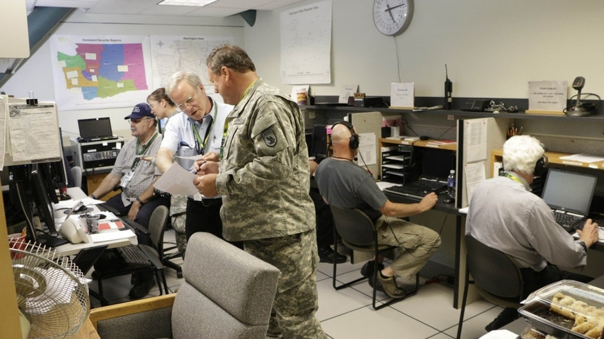 Volunteer radio operators participate in an earthquake and tsunami readiness drill, Tuesday, June 7, 2016, at Camp Murray, Wash.