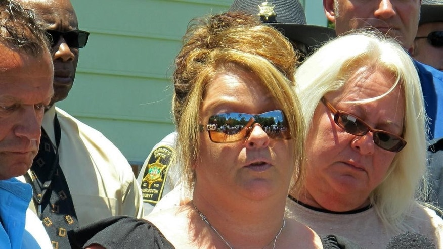 Dawn Drexel, mother of Britanee Drexel, speaks to reporters during a news conference in McClellanville, S.C., on Wednesday, June 8, 2016. Authorities announced that the case of the disappearance of her daughter Brittanee Drexel of Rochester, N.Y., is now being investigated as a homicide and the FBI is offering a reward of $25,000 for information leading to the arrest and conviction of those responsible. Brittanee Drexel was 17 when she was last seen at a hotel in nearby Myrtle Beach, S.C., in April 2009. (AP Photo/Bruce Smith)