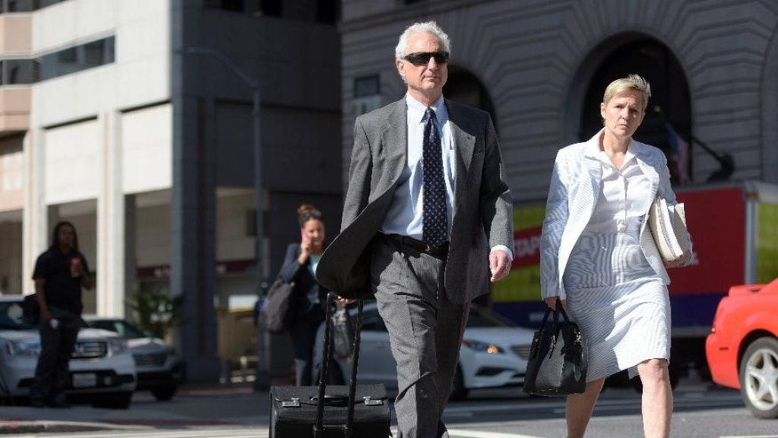 Chief Deputy State's Attorney Michael Schatzow, left, and Deputy State's Attorney Janice Bledsoe, right, arrive for the first day of the trial of Officer Caesar Goodson, not pictured, charged with murder in the death of of Freddie Gray, Thursday, June 9, 2016. Goodson, the driver of the transport wagon that carried Gray after his arrest, faces second-degree murder, manslaughter and other charges. (AP Photo/Steve Ruark)