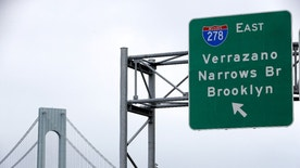 A road sign indicating an entrance to the Verrazano-Narrows Bridge is seen in New York, Wednesday, June 8, 2016. It's an error that has loomed over New York Harbor for more than 50 years: The name of the majestic Verrazano-Narrows Bridge is spelled wrong. Despite a new petition drive to make it right — the bridge is named for 16th-century Italian explorer Giovanni da Verrazzano (two Z's) — the state authority that controls the span has stubbornly held to the one Z position it's taken for years: We know it's wrong, but we're not changing it. (AP Photo/Seth Wenig)