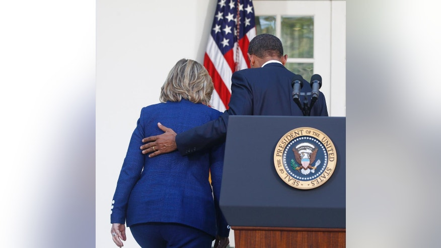 In this photo taken Sept. 1, 2010, President Barack Obama walks with then-Secretary of State Hillary Rodham Clinton after he made a statement in the Rose Garden of the White House in Washington. President Barack Obama formally endorsed Hillary Clinton's bid for the White House on Thursday, June 9, 2016, praising his former secretary of state's experience and grit, and urging Democrats to unite behind her in the fight against Republicans in the fall. (AP Photo/Charles Dharapak)