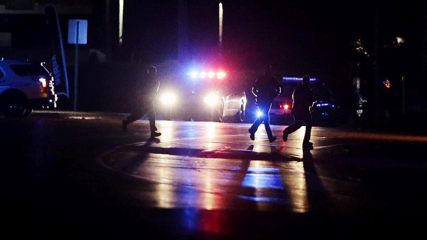 Police investigate the scene of a shooting from the intersection of Hwy 22 and Columbia Road on Thursday, June 9, 2016, in Landen, Ohio.
