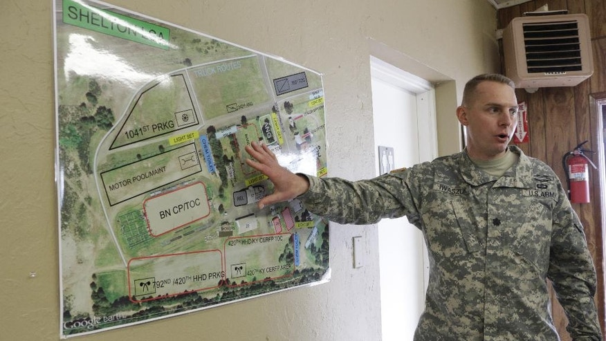 Washington National Guard Lt. Col. Adam Iwaszuk shows a map of operations for an earthquake and tsunami drill at the Mason County Fairgrounds in Shelton, Wash., Thursday, June 9, 2016. The area has been converted into a staging area with hundreds of members of the National Guard, a tactical operations center, a trauma center and various equipment, including decontamination trucks. (AP Photo/Rachel La Corte)