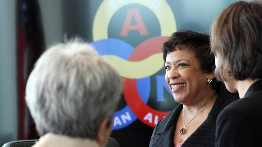 U.S. Attorney General Loretta Lynch, middle, greets Alaska Native leaders and others at a meeting Friday, June 10, 2016, in Anchorage, Alaska. Lynch discussed public safety and other issues affecting Alaska Natives at the meeting. (AP Photo/Mark Thiessen)
