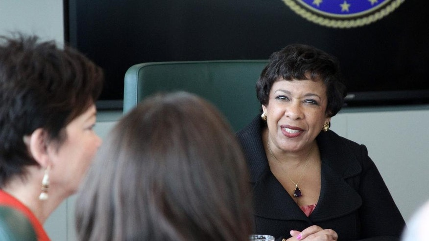 U.S. Attorney General Loretta Lynch, right, speaks with Alaska Native leaders and others at a meeting Friday, June 10, 2016, in Anchorage, Alaska. Lynch discussed public safety and other issues affecting Alaska Natives at the meeting. (AP Photo/Mark Thiessen)