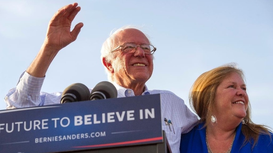 Democratic presidential candidate Sen. Bernie Sanders, I-Vt., and his wife Jane arrive onstage for a rally in Washington, Thursday, June 9, 2016. (AP Photo/Cliff Owen)