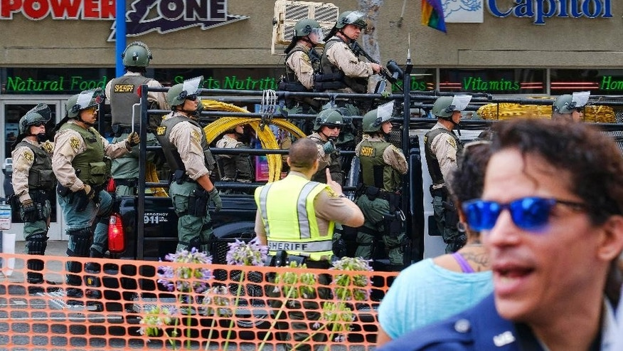 Los Angeles County Sheriff's deputies ride along a street in West Hollywood, Calif., during the gay pride Parade on Sunday, June 12, 2016. A heavily armed man arrested in Southern California told police he was in the area for West Hollywood's gay pride parade. (AP Photo/Richard Vogel)