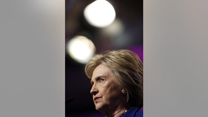 "File-This June 10, 2016, file photo shows Democratic presidential candidate Hillary Clinton pausing while speaking during a Planned Parenthood Action Fund membership event, in Washington. Republican Donald Trump plans Monday, June 13, 2016, to further address the deadliest shooting in modern U.S. history in a campaign speech originally intended to attack the presumptive Democratic nominee, Hillary Clinton. The switch comes a day after Trump called for Clinton to drop out of the race for president if she didn't use the words ""radical Islam"" to describe the Florida nightclub massacre. (AP Photo/Alex Brandon, File)"