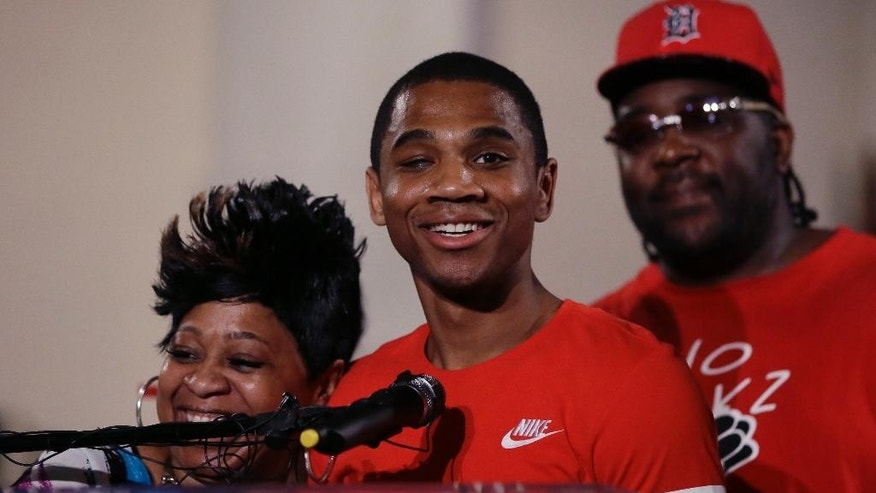 Davontae Sanford stands with his mother, Taminko Sanford and addresses the media during a news conference, Thursday, June 9, 2016 in Detroit. Sanford entered prison as a teenager in 2008 and was released Wednesday, a day after his guilty pleas to four fatal shootings were erased by a judge at the request of prosecutors who conceded the case was compromised by flawed police work. (AP Photo/Carlos Osorio)