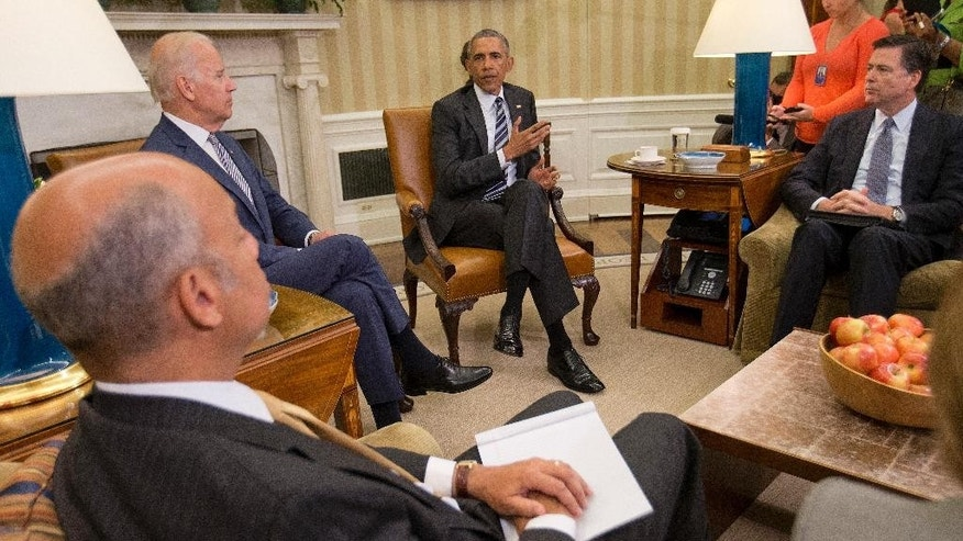 President Barack Obama, center, speaks to members of the media in the Oval Office of the White House in Washington, Monday, June 13, 2016, after getting briefed on the investigation of a shooting at a nightclub in Orlando by FBI Director James Comey, right, Homeland Security Secretary Jeh Johnson, left, and Vice President Joe Biden. (AP Photo/Pablo Martinez Monsivais)