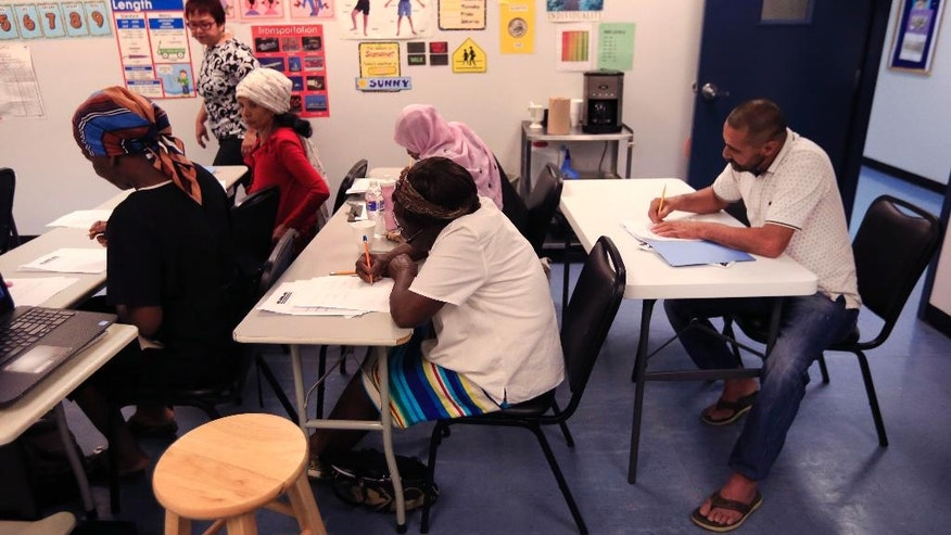 Syrian refugee Ahmad Alabood, right, sits in the back row during English class at Della Lamb Community Services in Kansas City, Mo., Monday, June 13, 2016. (AP Photo/Orlin Wagner)