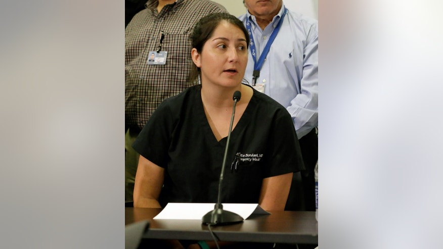 Dr. Kathryn Bondan, one of the doctors that treated victims of the Pulse nightclub shooting, speaks at a news conference at the Orlando Regional Medical Center Tuesday, June 14, 2016, in Orlando, Fla.  (AP Photo/John Raoux)