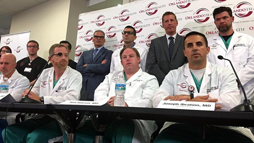Doctors and medical staff that treated the victims of the Pulse nightclub shooting answer questions at a news conference at the Orlando Regional Medical Center, Tuesday, June 14, 2016, in Orlando, Fla. (Naseem Miller/Orlando Sentinel via AP) MAGS OUT; NO SALES; MANDATORY CREDIT