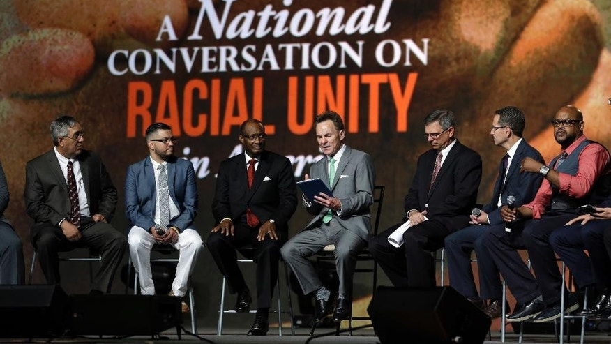 Pastor Ronnie Floyd, center, president of the Southern Baptist Convention, conducts a discussion on race with fellow religious leaders during a meeting of the Southern Baptist Convention Tuesday, June 14, 2016, in St. Louis. (AP Photo/Jeff Roberson)