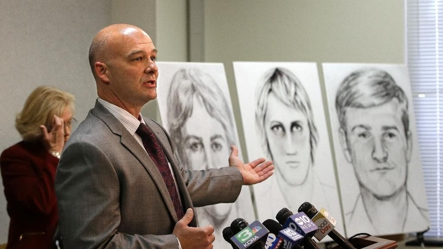 Sgt. Paul Belli, of the Sacramento County Sheriff's Department homicide bureau, gestures toward law enforcement drawings of a suspected serial killer believed to have committed at least 12 murders across California in the 1970's and 1980's at a news conference Wednesday, June 15, 2016, in Sacramento, Calif. Authorities announced a $50,000 reward for the arrest and conviction of the person that along with murder, is suspected of committing at least 45 rapes and dozens of burglaries. (AP Photo/Rich Pedroncelli)