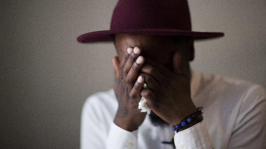 """Demetrice Naulings cries while recalling in an interview how he survived the mass shooting at the Pulse nightclub that claimed the life of his friend Eddie Justice Tuesday, June 14, 2016, in Orlando, Fla. """"I'm not going to get a chance to get another friend like that anymore,"""" said Naulings. """"Eddie was my angel."""" (AP Photo/David Goldman)"""