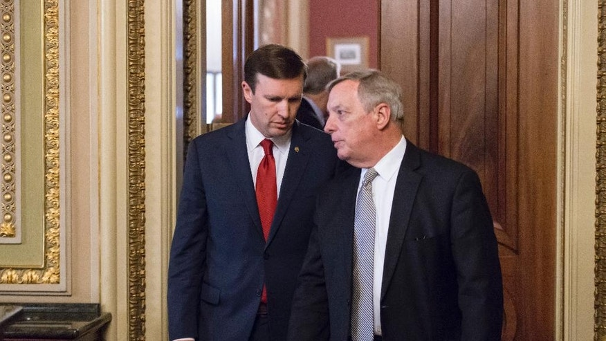In this photo taken June 14, 2016, Sen. Chris Murphy, D-Conn., left, confers with Senate Minority Whip Richard  Durbin, D-Ill., emerge from a closed-door party caucus on Capitol Hill in Washington. Murphy is launching a filibuster and demanding a vote on gun control measures. The move comes three days after people were killed in a mass shooting in Orlando. (AP Photo/J. Scott Applewhite)