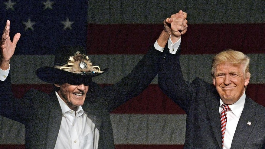 Republican Presidential hopeful Donald Trump introduces NASCAR great Richard Petty as he takes the stage at a rally at the Greensboro Coliseum in Greensboro Special Events Center in Greensboro, N.C. Tuesday, June 14, 2016. (Chuck Liddy/The News & Observer via AP) MANDATORY CREDIT