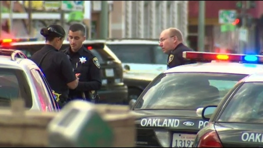 June 14, 2016: Police respond to the scene of a shooting in downtown Oakland, Calif.